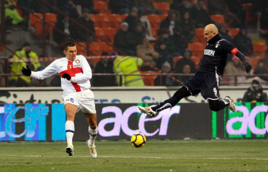 Lucio of FC Internazionale Milano competes for the ball with Tommaso Rocchi of SS Lazio during the Serie A match between Inter Milan and Lazio at Stadio Giuseppe Meazza on December 20, 2009 in Milan, Italy.