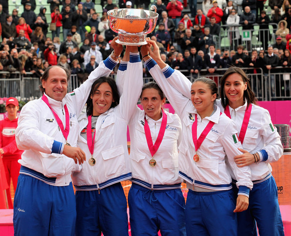 Team of Italy (left Corrado Barazzutti, Francesca Schiavone, Roberta Vinci, Sara Errani,Flavia Pennetta) lift the trophy after the final match of the Fed Cup World Group between Italy and the USA at Circolo Tennis Rocco Polimeni on November 8, 2009 in Reggio Calabria, Italy.