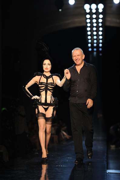 Dita Von Teese and designer Jean-Paul Gaultier walk the runway during the Jean-Paul Gaultier show as part of the Paris Haute Couture Fashion Week Fall/Winter 2011 on July 7, 2010 in Paris, France.