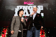 Nick Jonas (L) and radio personality Matt Siegel speak onstage during KISS 108's Jingle Ball 2014, presented by Market Basket Supermarkets at TD Garden on December 14, 2014 in Boston, Massachusetts.