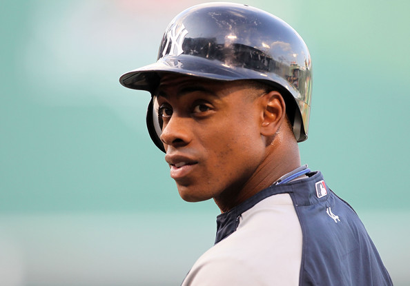 Curtis Granderson Curtis Granderson #14 of the New York Yankees warms up before a game against the Boston Red Sox at Fenway Park on April 7, 2010 in Boston, Massachusetts.