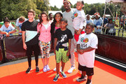 New York Knicks  J.R. Smith poses with actors  (L-R) Jack Griffo,  Kira Kosarin, Sydney Park and Tylen Jacob Williams during  Nickelodeon's 11th Annual Worldwide Day of Play at Prospect Park on September 20, 2014 in New York City.