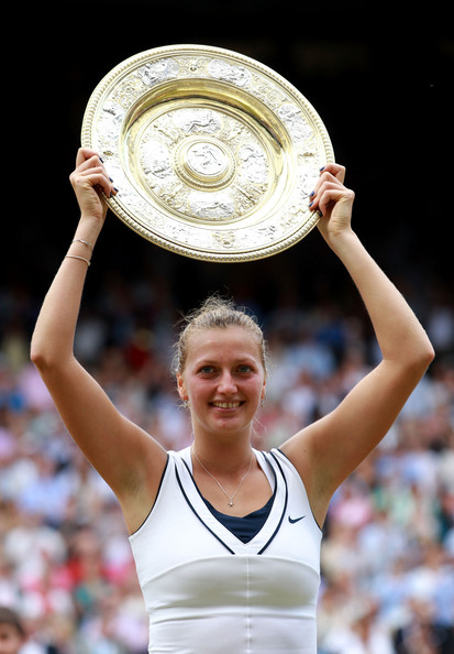 Petra Kvitova Petra Kvitova of the Czech Republic holds up the Championship trophy after winning her Ladies' final round match against Maria Sharapova of Russia on Day Twelve of the Wimbledon Lawn Tennis Championships at the All England Lawn Tennis and Croquet Club on July 2, 2011 in London, England.  Kvitova won 6-3 6-4.