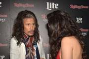 Recording artists Steven Tyler (L) of Aerosmith (L) and Charli XCX attend Rolling Stone LIVE Presented By Miller Lite at The Venue of Scottsdale on January 31, 2015 in Scottsdale, Arizona.