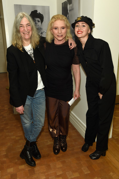 (L-R) Patti Smith, Debbie Harry and Miley Cyrus pose backstage Carnegie Hall the Tibet House Benefit Concert 2015 on March 5, 2015 in New York City.