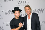 """Nick Jonas (L) and photographer Russell James attend Russell James' """"Angel"""" book launch hosted by Victoria's Secret on September 10, 2014 in New York City."""