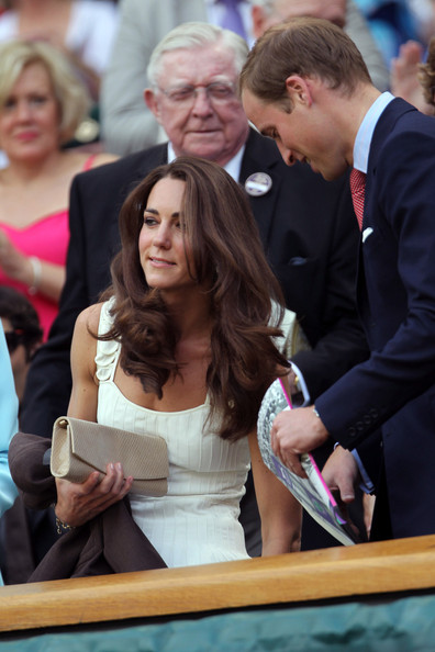 Kate Middleton The Duchess of Cambridge, shares some intimate moments with Prince William as they watch Andy Murray play against Richard Gasquet of France on centre court at Wimbledon. The Duchess wore a Temperley Moriah cream pleated dress.