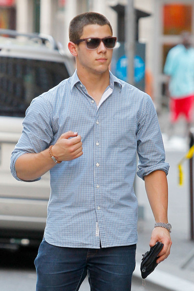 Nick Jonas Hails A Cab Outside His Apartment In New York City