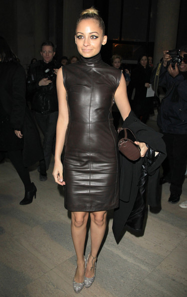 Nicole Richie Nicole Richie dressed in a fabulous brown leather dress  joins a celebrity audience at the Givenchy Ready to Wear Autumn/Winter 2011/2012 show in Paris as part of Paris Fashion Week.