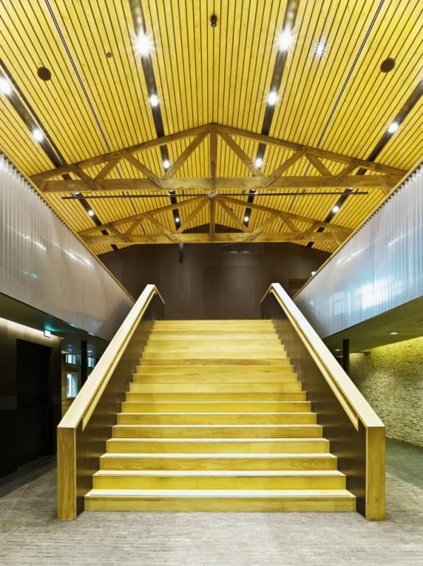 The staircase can be used as a tribune during acoustic concerts in the foyer, Image Courtesy ©  Petra Appelhof