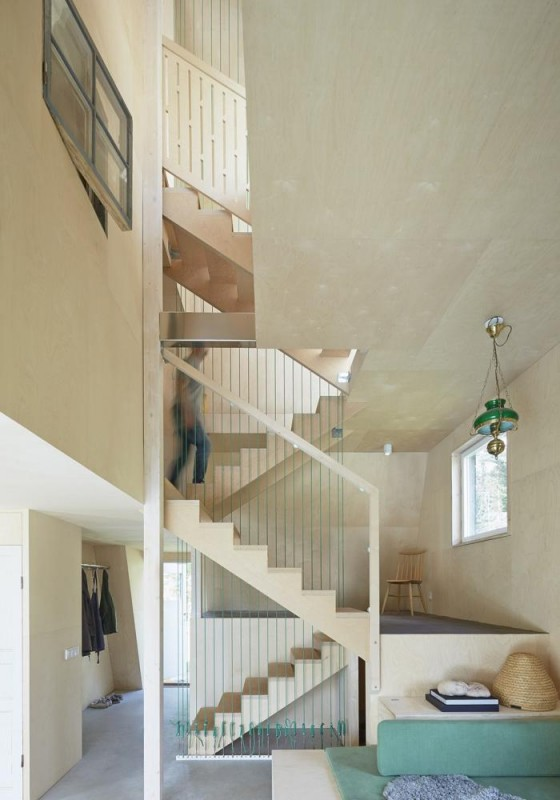 The floors are linked by the staircase that zigzags up between the five levels, Image Courtesy © Åke E:son Lindman