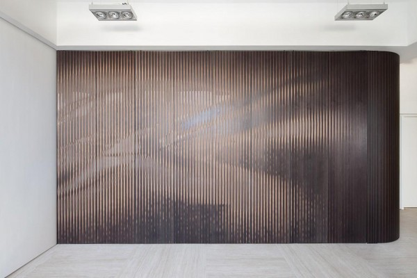 The ArtWall forms a flexible, translucent screen that hides a built-in sliding door, Image Courtesy © Dennis Lo Designs