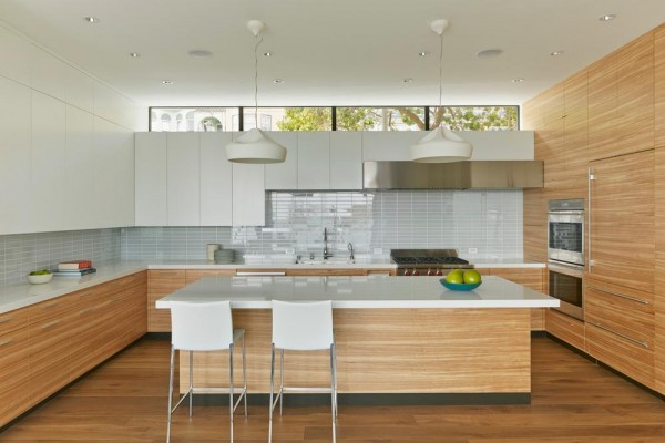 Random-matched olive ash veneer runs throughout the kitchen, Image Courtesy © Bruce Damonte