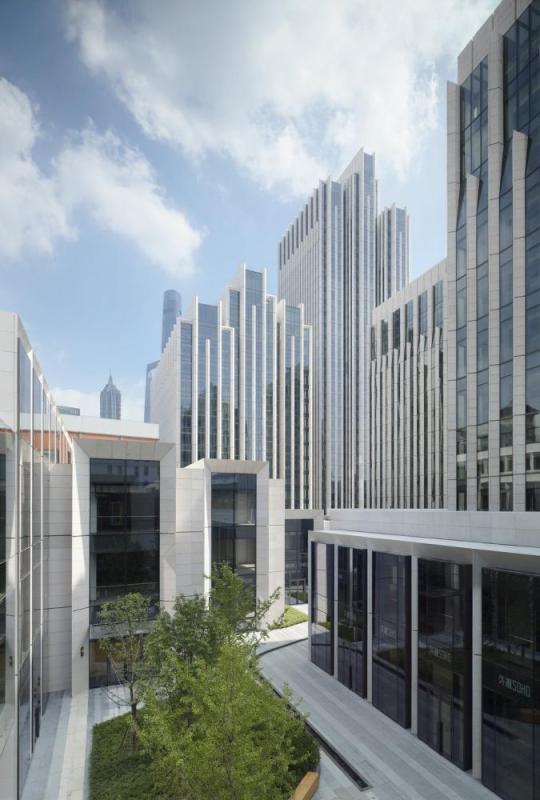 Matching the scale of neighboring buildings, Image Courtesy © gmp Architekten von Gerkan, Marg und Partner
