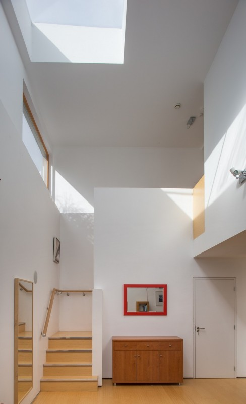 double-height void – roof-light & high level window draw natural light into the building, Image Courtesy © Paul Tierney