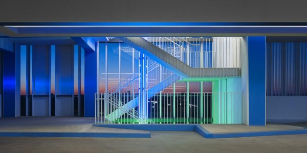 One of four stairways within the building.  Colored light identifies the floor level beginning at the stair and continues into the parking level.  The exterior glass provides a wind break, Image Courtesy © Scott McDonald (Hedrich Blessing)
