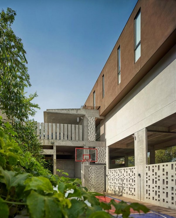View towards car porch/ basketball court , Image Courtesy © Keat Song (Staek Photography)