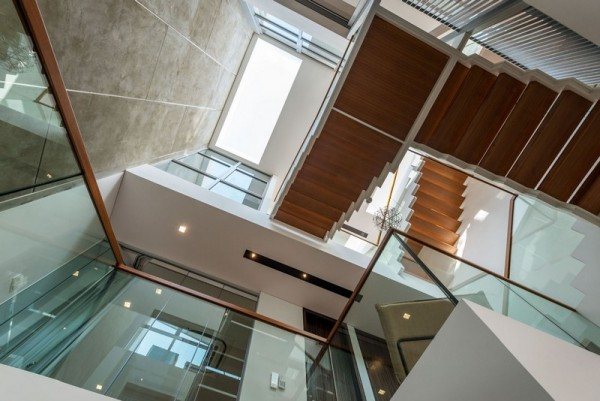 Central light well & steel structure staircase, Image Courtesy © IX Architects Pte Ltd