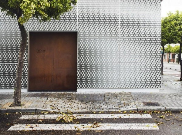 South facade_ Corten steel door shows the entrance to the restaurant, Image Courtesy © Alfonso Calza