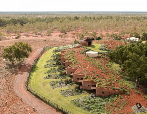 Rammed earth extracted from the local clay pans, pebbles and gravel quarried from the river bed are the palette of materials that blend into the landscape. The pavilion at the top is the multi-functional hub, meeting room and chapel., Image Courtesy © Edward Birch