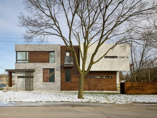 """Exterior View from West side. Elevation shows how it sits on its own site, with straightforward lines, and a play of expansive and narrow window designed to capture the """"right"""" amount of natural light while maintain the sense of privacy, Image Courtesy © Tom Arban"""