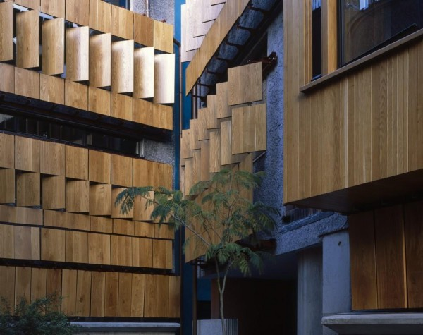 Courtyard detail showing staggered panels of timber shutters, Image Courtesy © Hélène Binet