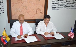 Carlos CU and FIU signing agreement