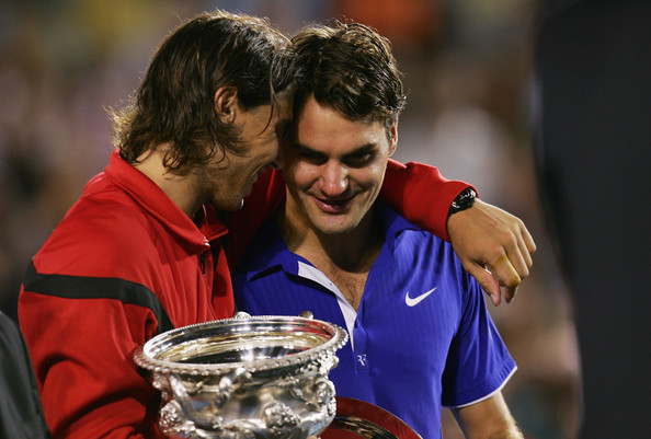 Roger Federer Rafael Nadal of Spain consoles Roger Federer of Switzerland during the trophy presentation after his men's final match during day fourteen of the 2009 Australian Open at Melbourne Park on  February 1, 2009 in Melbourne, Australia.  (Photo by Scott Barbour/Getty Images) *** Local Caption *** Roger Federer;Rafael Nadal