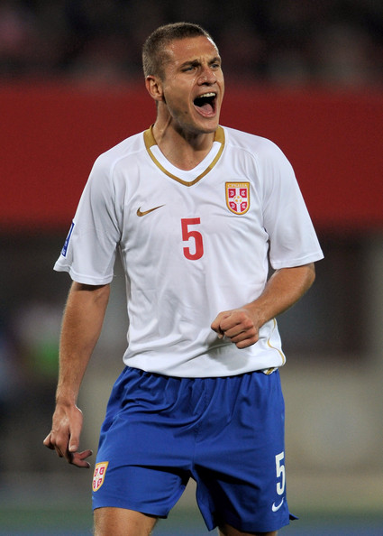 Nemanja Vidic of Serbia shouts encouragement during the FIFA 2010 World Cup Qualifying Group 7 match between Austria and Serbia at the Ernst Happel Stadium on October 15, 2008 in Vienna, Austria.  (Photo by Shaun Botterill/Getty Images) *** Local Caption *** Nemanja Vidic