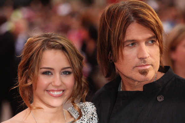 Actress Miley Cyrus and father Billy Ray Cyrus arrives at the UK film premiere of 'Hannah Montana: The Movie' held at the Odeon, Leicester Square on April 23, 2009 in London, England.  (Photo by Tim Whitby/Getty Images) *** Local Caption *** Miley Cyrus;Billy Ray Cyrus