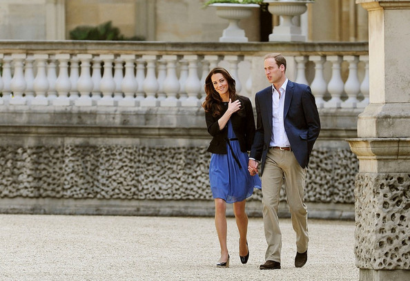 "On the day after the ""Wedding of the Century,"" Prince William and Catherine Middleton, the Duke and Duchess of Cambridge, stroll hand-in-hand on the grounds of Buckingham Palace before they are to leave for their honeymoon."