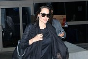 Actress and busy mom Angelina Jolie arriving on a flight at LAX airport in Los Angeles, California on January 27, 2015. Angelina is returning from Iraq where she continued in her role as UN envoy, highlighting the needs of refugees.