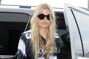 Singer Fergie look alike she's ready for to play some football while departing on a flight at LAX in Los Angeles, California on September 20, 2014.