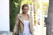Singer and actress Hilary Duff shows off her keen fashion sense while leaving the gym after a workout on August 22, 2014 in West Hollywood, California. When Hilary arrived to her Mercedes SUV she was surpised to find a parking ticket waiting for her!
