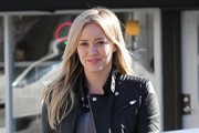 Singer and actress Hilary Duff stops to grab some Thai food to go in Toluca Lake, California on December 26, 2014. Hilary was taking the tasty lunch to her mom's house to chow down.