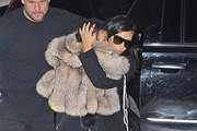 Reality star Kim Kardashian carries her daughter North as they return to their apartment in New York City, New York on February 11, 2015.