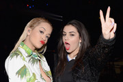 Singers Rita Ora (L) and Charli XCX attend 103.5 KISS FM's Jingle Ball 2014 at Allstate Arena on December 18, 2014 in Chicago, Illinois.