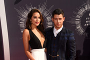 Musician Nick Jonas (R) and Olivia Culpo attend the 2014 MTV Video Music Awards at The Forum on August 24, 2014 in Inglewood, California.