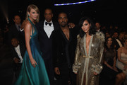 (L-R) Recording Artists Taylor Swift, Jay Z and Kanye West and tv personality Kim Kardashian attend The 57th Annual GRAMMY Awards at the STAPLES Center on February 8, 2015 in Los Angeles, California.