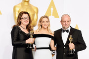(L-R) Frances Hannon, actress Reese Witherspoon, and Mark Coulier, winner of the Best Makeup & Hairstyling Award for 'The Grand Budapest Hotel' pose in the press room during the 87th Annual Academy Awards at Loews Hollywood Hotel on February 22, 2015 in Hollywood, California.