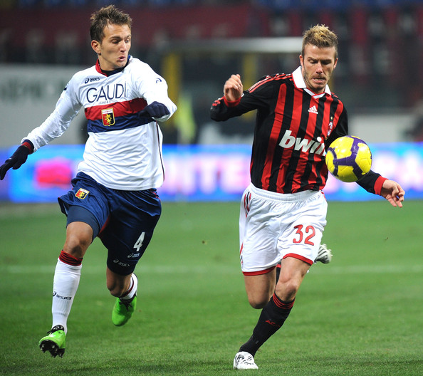 David Beckham of AC Milan battles for the ball against Domenico Criscito of Genoa CFC during the Serie A match between AC Milan and Genoa CFC at Stadio Giuseppe Meazza on January 6, 2010 in Milan, Italy.