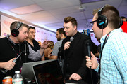 (L-R) Radio personality Mike Miller from Kiss FM Harrisburg, musician Sam Smith and radio personality Kyle Anthony from B104 interviews backstage at the Q102's Jingle Ball 2014 at Wells Fargo Center on December 10, 2014 in Philadelphia, Pennsylvania.