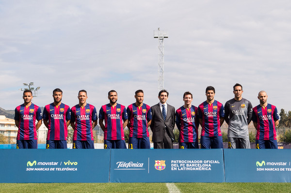 (L-R) Douglas, Rafinha, Adriano Correia, Dani Alves, Neymar, Telefonica CEO Jose Maria Alvarez Pallete, Lionel Messi, Luis Suarez, Claudio Bravo and Javier Mascherano of FC Barcelona pose during the presentation of a partnership agreement at Ciudad Deportiva de Sant Joan Despi on February 18, 2015 in Barcelona, Spain.