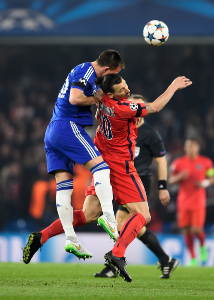 John Terry of Chelsea rises above Zlatan Ibrahimovic of PSG to win a header during the UEFA Champions League Round of 16, second leg match between Chelsea and Paris Saint-Germain at Stamford Bridge on March 11, 2015 in London, England.