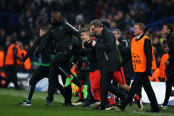 Laurent Blanc the head coach of PSG and his players celebrate following their team's victory in extra time during the UEFA Champions League Round of 16, second leg match between Chelsea and Paris Saint-Germain at Stamford Bridge on March 11, 2015 in London, England.