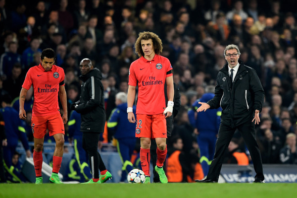 Laurent Blanc the head coach of PSG reacts as his players prepare for extra time during the UEFA Champions League Round of 16, second leg match between Chelsea and Paris Saint-Germain at Stamford Bridge on March 11, 2015 in London, England.
