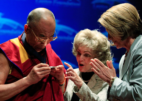 Pelosi House Speaker Nancy Pelosi (D-CA) (R) presents the Dalai Lama ...