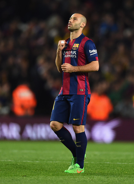 Javier Mascherano of Barcelona celebrates as Luis Suarez  scores their second goal during the La Liga match between FC Barcelona and Real Madrid CF at Camp Nou on March 22, 2015 in Barcelona, Spain.