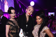 (L-R) Performer Dita Von Teese, singer/songwriter Miley Cyrus, and rapper Lil' Kim attend the 23rd Annual Elton John AIDS Foundation Academy Awards Viewing Party on February 22, 2015 in Los Angeles, California.