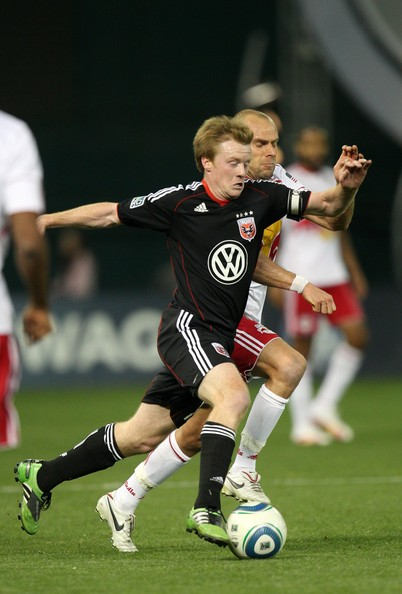 Joel Lindpere Dax McCarty #10 of D.C. United controls the ball against Joel Lindpere #20 of the New York Red Bulls at RFK Stadium on April 21, 2011 in Washington, DC.